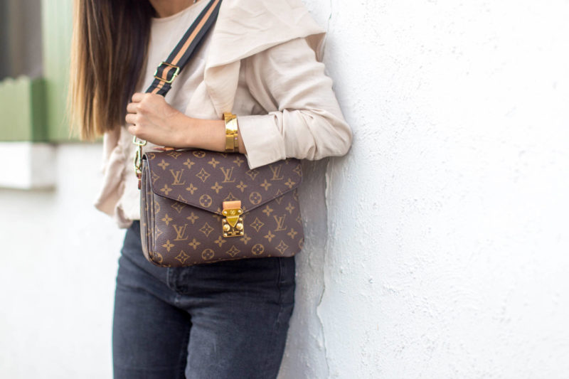 37ae22c57281 How to update any handbag in your collection with the trendy guitar strap